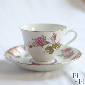 Pink and white floral tea cup and small plate